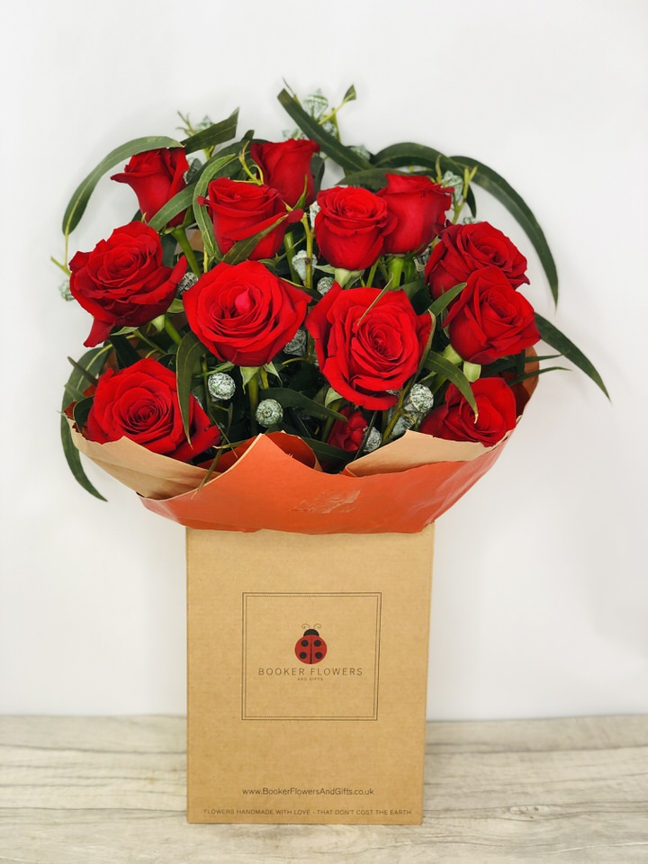 12 Red Roses Handtied Bouquet: Booker Flowers and Gifts