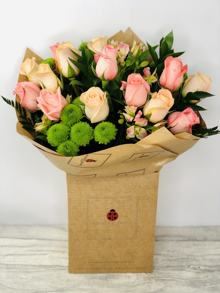 Celebrating Coral Rose Handtied Bouquet Extra Large: Booker Flowers and Gifts