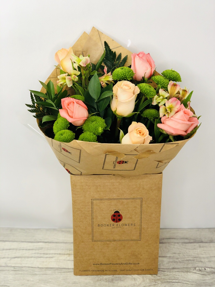 Celebrating Coral Rose Handtied Bouquet: Booker Flowers and Gifts