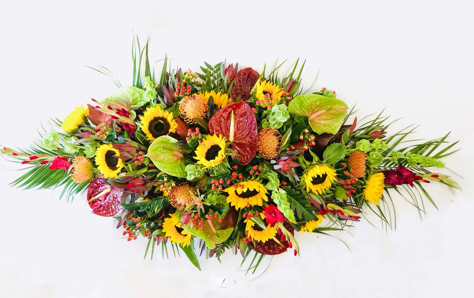Tropical Flower Casket Spray: Booker Flowers and Gifts