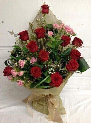 Valentines Luxury Dozen Red Roses Hand Tied Bouquet: Booker Flowers and Gifts